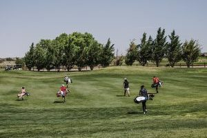 Golfers walking on the course